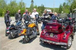 Motorcyclists have a riders' meeting before taking a group ride