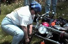 Member shows how to lift a fallen motorcycle